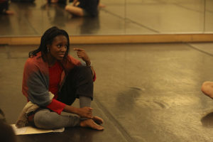 Sheron Wray seated in a dance studio teaching